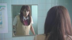 Yamada looks in mirror